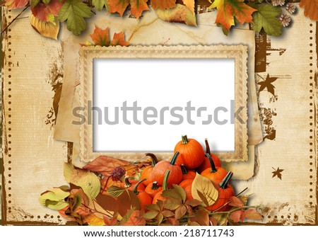 Vintage background with pumpkin, autumn leaves and place for text or photo - stock photo