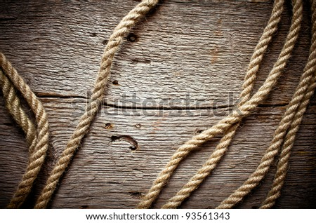 Vintage background with wooden log and hemp rope - stock photo