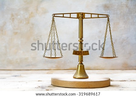 vintage balance scales made of brass, concept for justice - stock photo