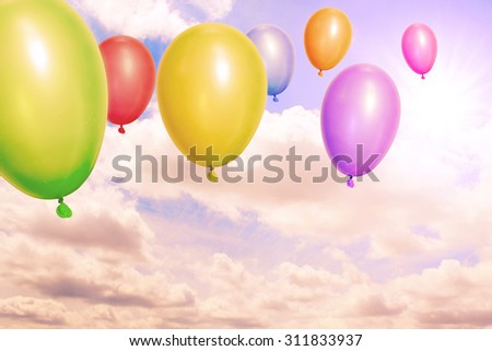 Vintage balloons over sky - stock photo