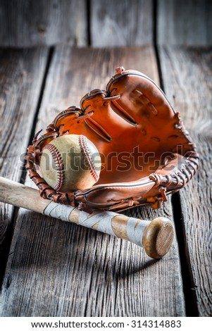 Vintage baseball glove and old ball - stock photo