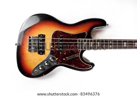 Vintage bass guitar on a white background - stock photo