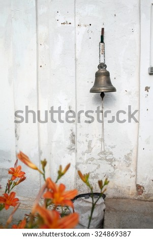 Vintage bell at the door of monastery hostel in provincial Russia - stock photo