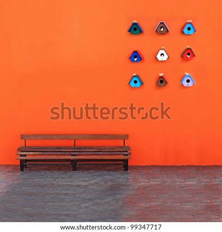 Vintage Bench Against blank Wall with Bird's nest - stock photo
