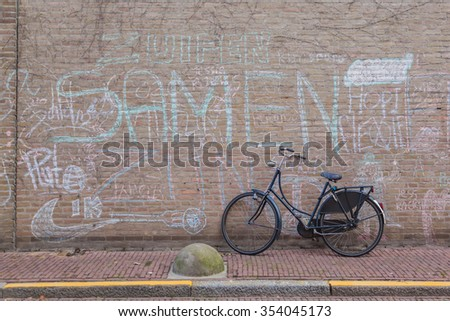 Vintage bicycle agains grunge brick wall background - stock photo