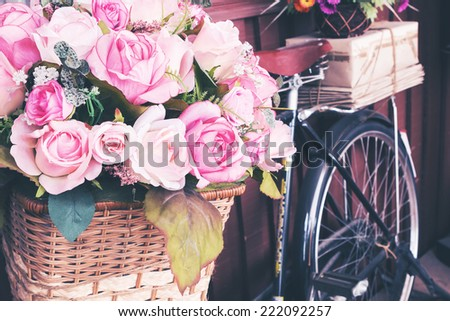 Vintage bicycle and flowers - stock photo