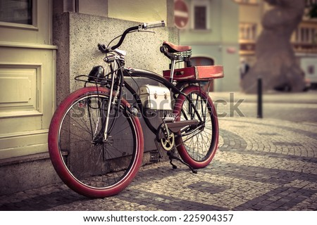 Vintage bicycle at the city - stock photo
