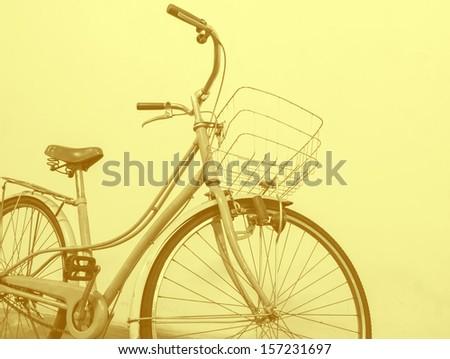 vintage bicycle color tone technique by program - stock photo