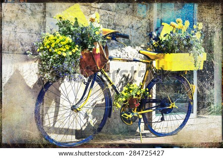 vintage bicycle decorated with flowers, artistic retro picture - stock photo