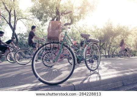 Vintage bicycle in a publicpark, Thailand - stock photo