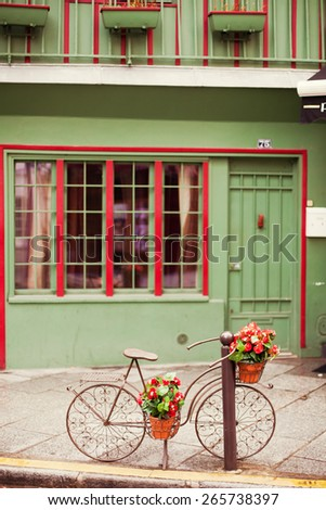 vintage bicycle parking near cute house - stock photo