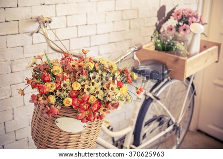 vintage bicycle with welcome sign on vintage white brick wall,warm and pastel,split toned. - stock photo
