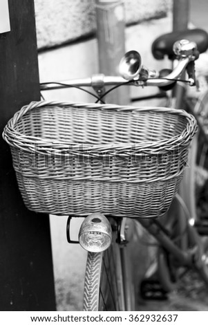 vintage bicycle with wicker basket placed on a wall .Roma - stock photo