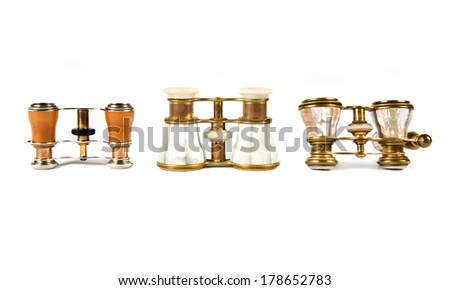 Vintage binoculars over isolated white background - stock photo