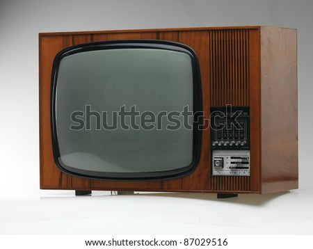 vintage black and white tv on gray background, side view - stock photo