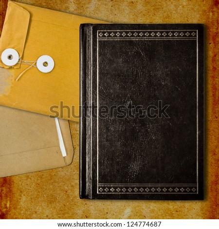 Vintage black book and envelopes background - stock photo
