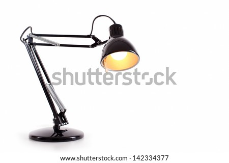 Vintage black desk lamp isolated on white - stock photo