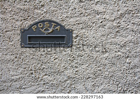Vintage Black Iron Mailbox built into the facade of the house  - stock photo