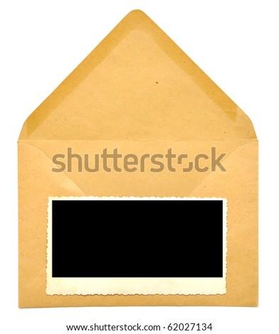 vintage blank photo frame on paper envelope - stock photo