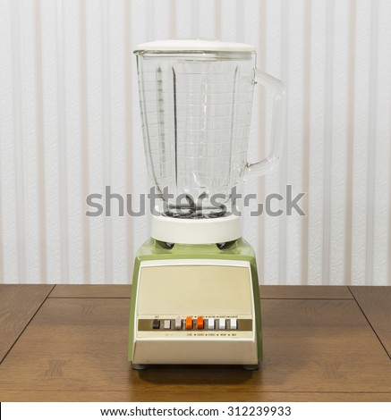 Vintage blender on wood table.   - stock photo