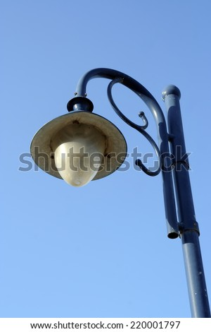 Vintage blue lamp post. Street light post in vintage style. - stock photo