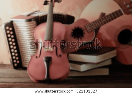 Vintage blur acoustic musical instruments guitar ukulele violin and accordion still life style - stock photo