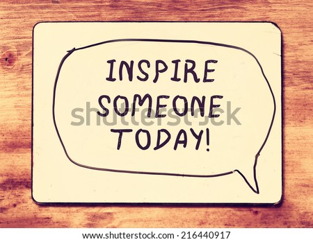 vintage board with the phrase inspire someone today written on it .retro filtered image - stock photo