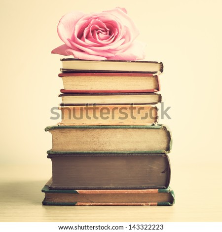 Vintage Books and Rose - stock photo