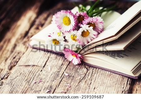 Vintage books with bouquet of flowers/ nostalgic vintage background - stock photo