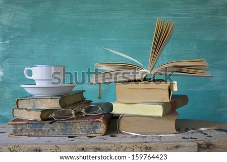 vintage books, with coffee cup and spectacles, free copy space - stock photo