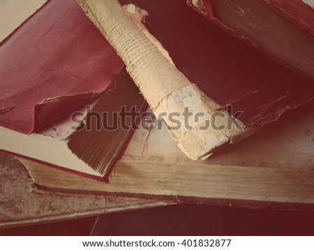 Vintage books with curled edges, fraying and missing parts - stock photo