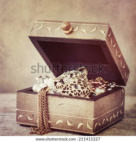 Vintage box with jewelry - stock photo