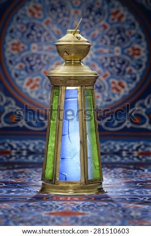 Vintage Brass Lantern over Ramadan Fabric Background - stock photo