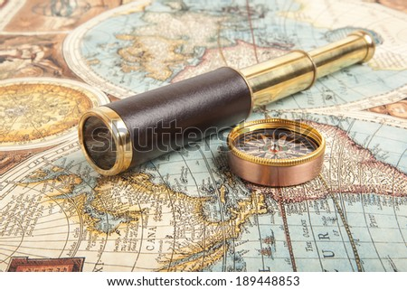 Vintage brass telescope on old antique map  - stock photo