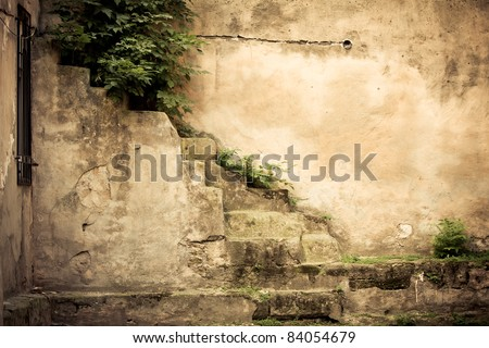 vintage brick wall background with old window - stock photo