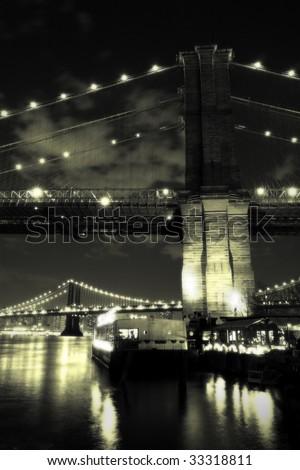 Vintage Brooklyn Bridge at night - stock photo