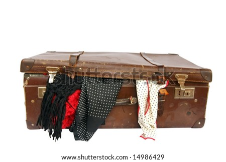 Vintage brown leather suitcase, with scarves overflowing.  Clipping path included. - stock photo