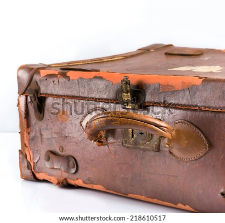 Vintage brown suitcase on white background - stock photo