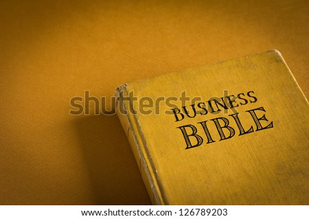 Vintage Business Bible with business commandments and rules - stock photo