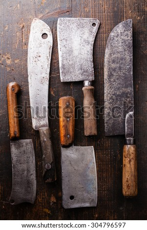 Vintage Butcher meat cleavers on dark wooden background - stock photo