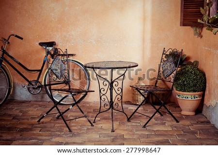vintage cafe with bicycle on the street - stock photo