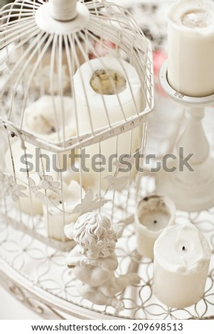 vintage cage with candle - stock photo