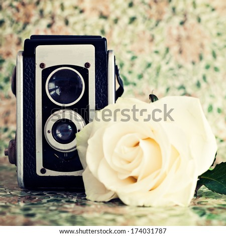 Vintage camera and rose  - stock photo