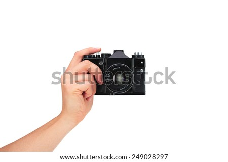 Vintage camera in hand on white background - stock photo