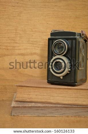 Vintage camera on book  - stock photo