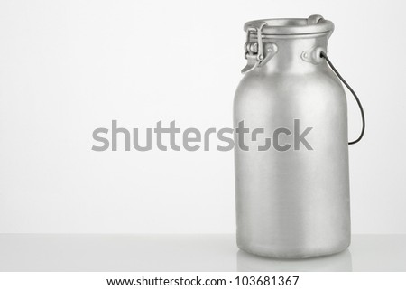 vintage can of milk  on neutral background - stock photo