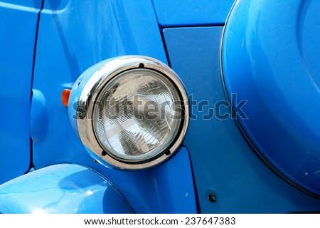 Vintage car headlight - stock photo