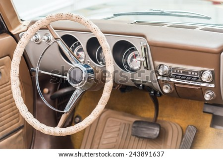 Vintage Car Interior With Retro Dashboard - stock photo