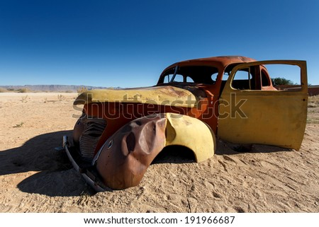 Vintage Car Wreck at Solitaire Town, Sossusvlei in the Namib Desert, Namibia, Africa - stock photo