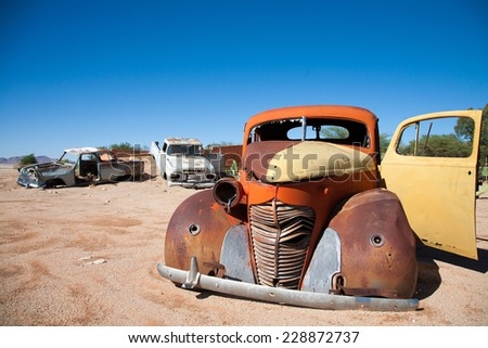 Vintage Car Wrecks at Solitaire Town, Sossusvlei in the Namib Desert, Namibia, Africa - stock photo